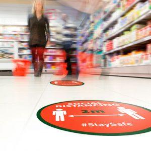 Golvgrafik håll avståndet i butiken